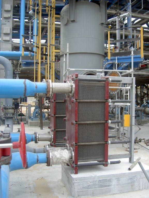 Conventional heat exchanger in a refinery facility. The cost of the entire facility is billions of shekels. Cooled water from the heat exchangers refrigerates extremely expensive equipment. Reliability of equipment in refineries is a key requirement.